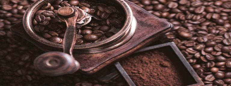 hand-grinder-with-green-coffee-beans-whole-and-ground-beans