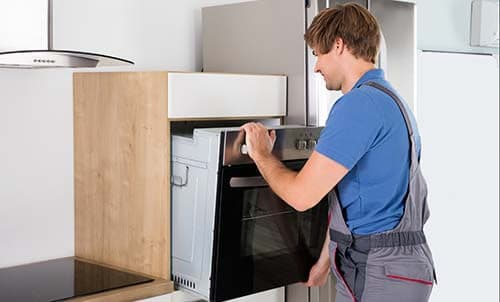 man-fitting-built-in-oven